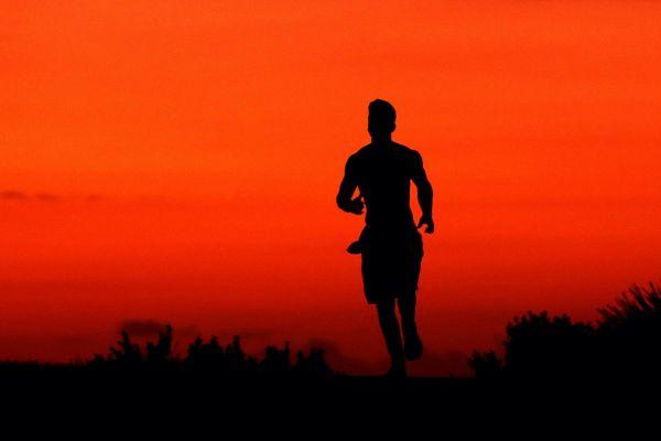 running at sunset -mental health marathon in COVID-19